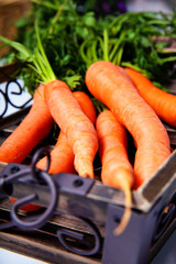 Young carrots in a box
