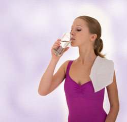 Fitness Woman Drinks Water