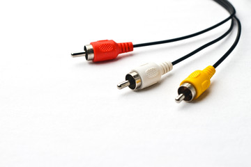 3 color av cable wrapping around on faded white background