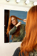 Beautiful red head woman uneasy about cutting hair