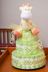 Green and yellow gender neutral diaper cake