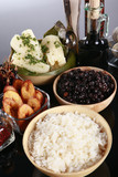 Staple latino sides, manioc, rice, plantains, and black beans poster