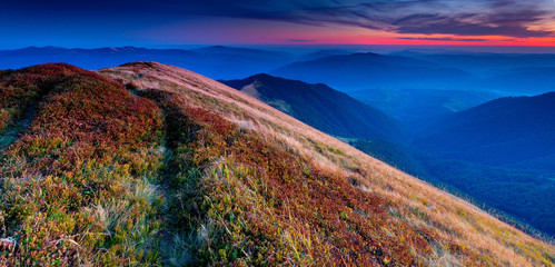 Panorama of colorful autumn landscape in the mountains. Sunset