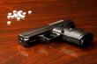 Nine millimeter gun on surface with white pills