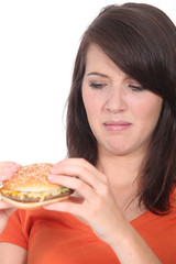 Woman stood holding cheeseburger