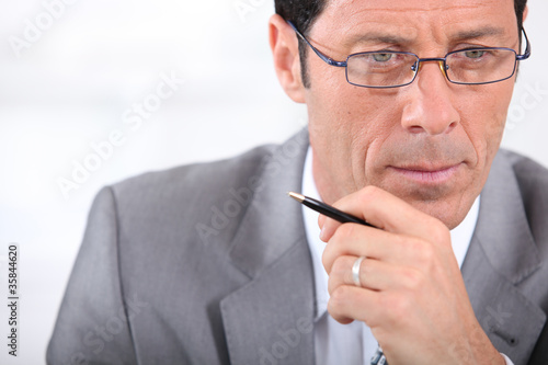Closeup of a businessman in glasses