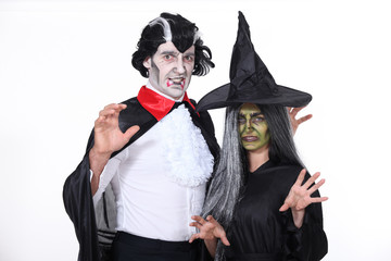 Man and woman in Halloween costumes
