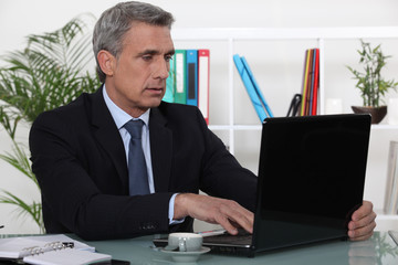 businessman working in his office