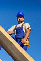 Carpenter worker on top of roof