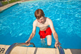 child has fun in the pool