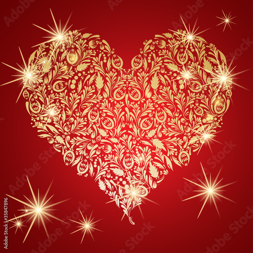 Abstract golden floral heart with glowing lights