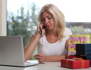 woman with credit card shopping on the internet