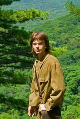 Young man in taiga 6