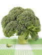 A head of broccoli on a checkered napkin