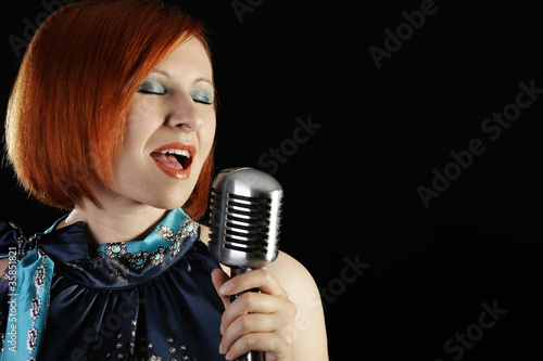 Retro  female singer with microphone
