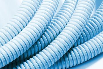 blue plastic curvilinear hoses