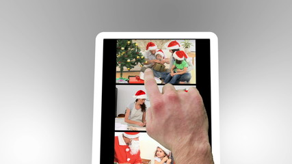 Tablet being used to watch christmas related family films