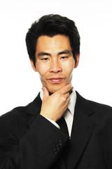 Asian businessman thinking