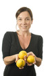 woman offering fresh lemons