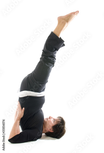 woman yoga position toe raise Half Shoulderstand -- Ardha Sarvan