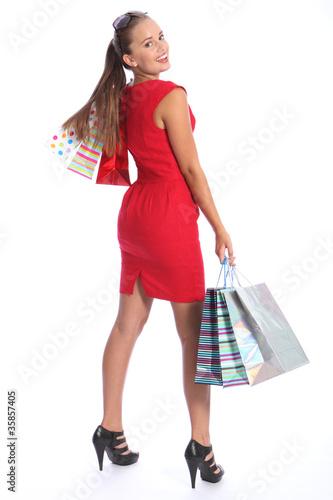 Beautiful woman in red dress has fun shopping