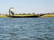 Fishermen in a pirogue in the Niger river.
