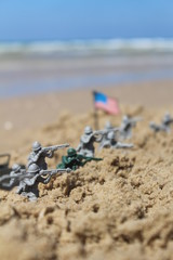 US toy soldiers on a fight near the sea with the american flag