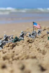US toy soldiers on a fight near the sea