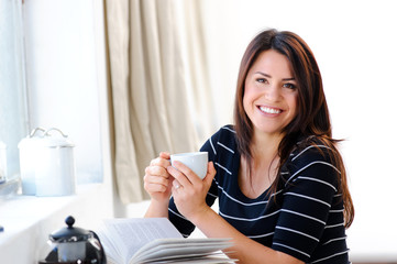 Happy woman with tea