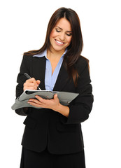 Businesswoman writing into planner