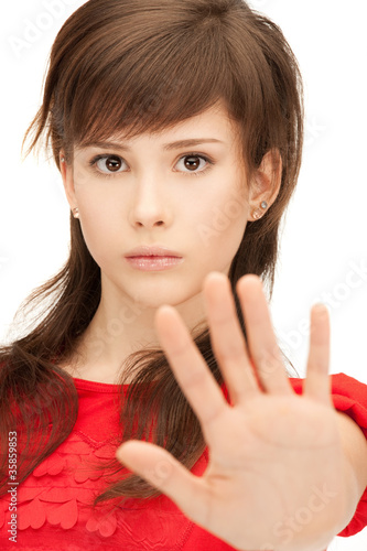 teenage girl making stop gesture