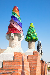 The mosaic chimneys made of broken ceramic tiles
