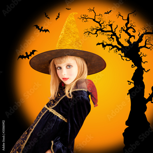 Halloween beautiful girl in dried tree bat