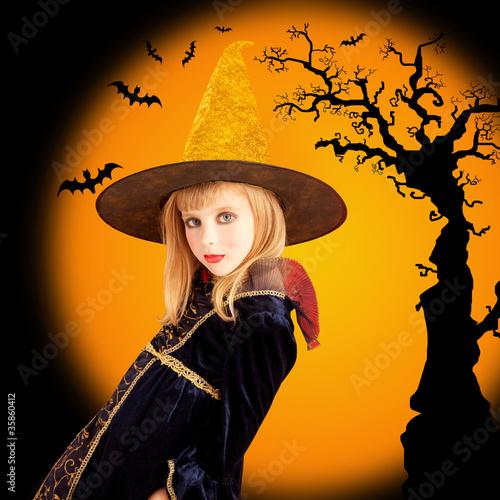 Halloween beautiful girl in dried tree bat