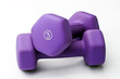 A pair of 3 lb purple neoprene weights stacked