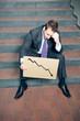 Desperate businessman showing negative graph
