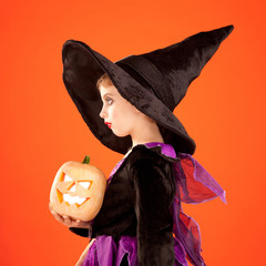 Halloween kid girl costume on orange