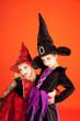 Halloween sister kid girls on orange