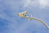 outdoor cctv camera against blue sky poster