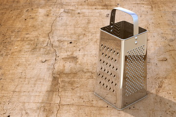 Grater on concrete