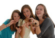Three teenage girls posing like cats tigers gritting teeth claws