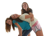 Three teenage girls having friendly fun together
