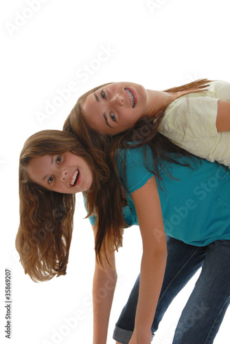 Two teenage girls horsing around