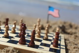 Chess board and soldiers, at the beach, with the American flag