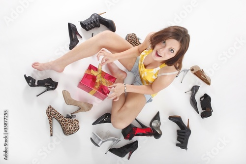young sexy beauty with shoes and a present