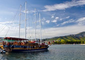 Old fashioned yacht sunny evening on quae