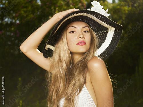 Leinwanddruck Bild Elegant lady in a hat