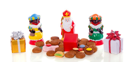 Traditional Dutch Sinterklaas and Piet with gingernuts and gifts