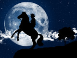 Cowboy with is horse at moonlight