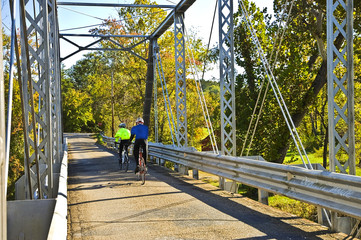 Bicycle Riders on Bridge